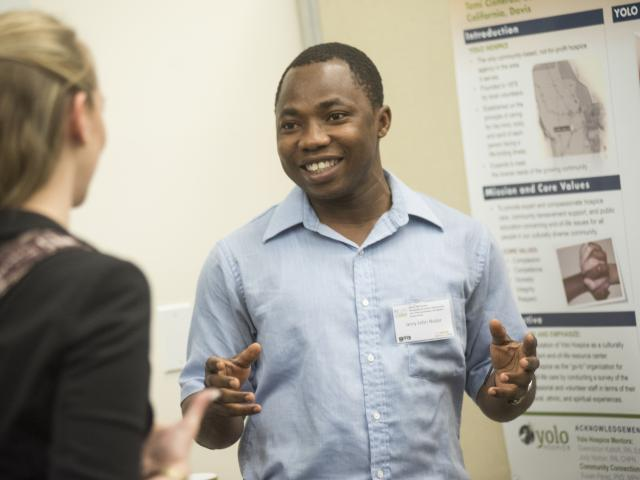 UC Davis student giving poster presentation